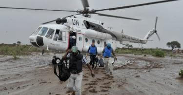 UN officials disembark from a helicopter near the town of Kurtunwaarey in the Lower Shabelle region of Somalia on November 20. The United Nations today conducted an inter-agency assessment mission in the recently liberated town of Kurtunwaarey, as part of an ongoing effort to assess the humanitarian needs of civilians living in former Al-Shabaab controlled areas. UN Photo / Tobin Jones